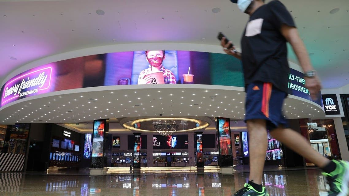 A man passes the VOX cinemas at the Mall of the Emirates in Dubai, United Arab Emirates, Thursday, April 15, 2021. The Middle East's largest operator of malls, Majid Al Futtaim, expects revenue and earnings to climb back to pre-pandemic levels by the end of next year and is moving full steam ahead with plans to develop its biggest mall ever. (AP)