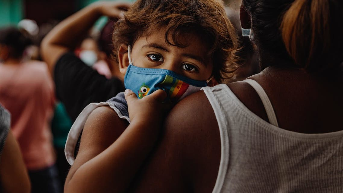 Child wearing a mask to protect against COVID-19 infection. (Unsplash, Taylor Brandon)
