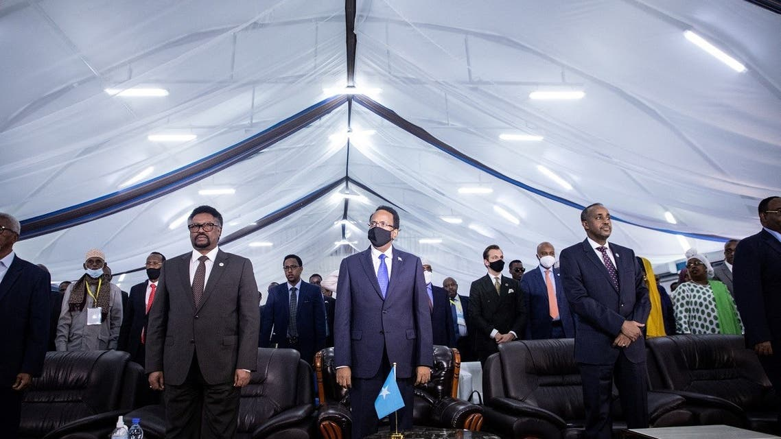Somalia's President Mohamed Abdullahi Mohamed (C), known as Farmajo, Somalia's Prime Minister Mohamed Hussein Roble (R) and Mohamed Mursal Sheikh Abdurahman (L), Speaker of the Somali parliament, attend the closing ceremony after reaching an agreement for the new elections at the National Consultative Council on Elections in Mogadishu, Somalia, on May 27, 2021. (AFP)