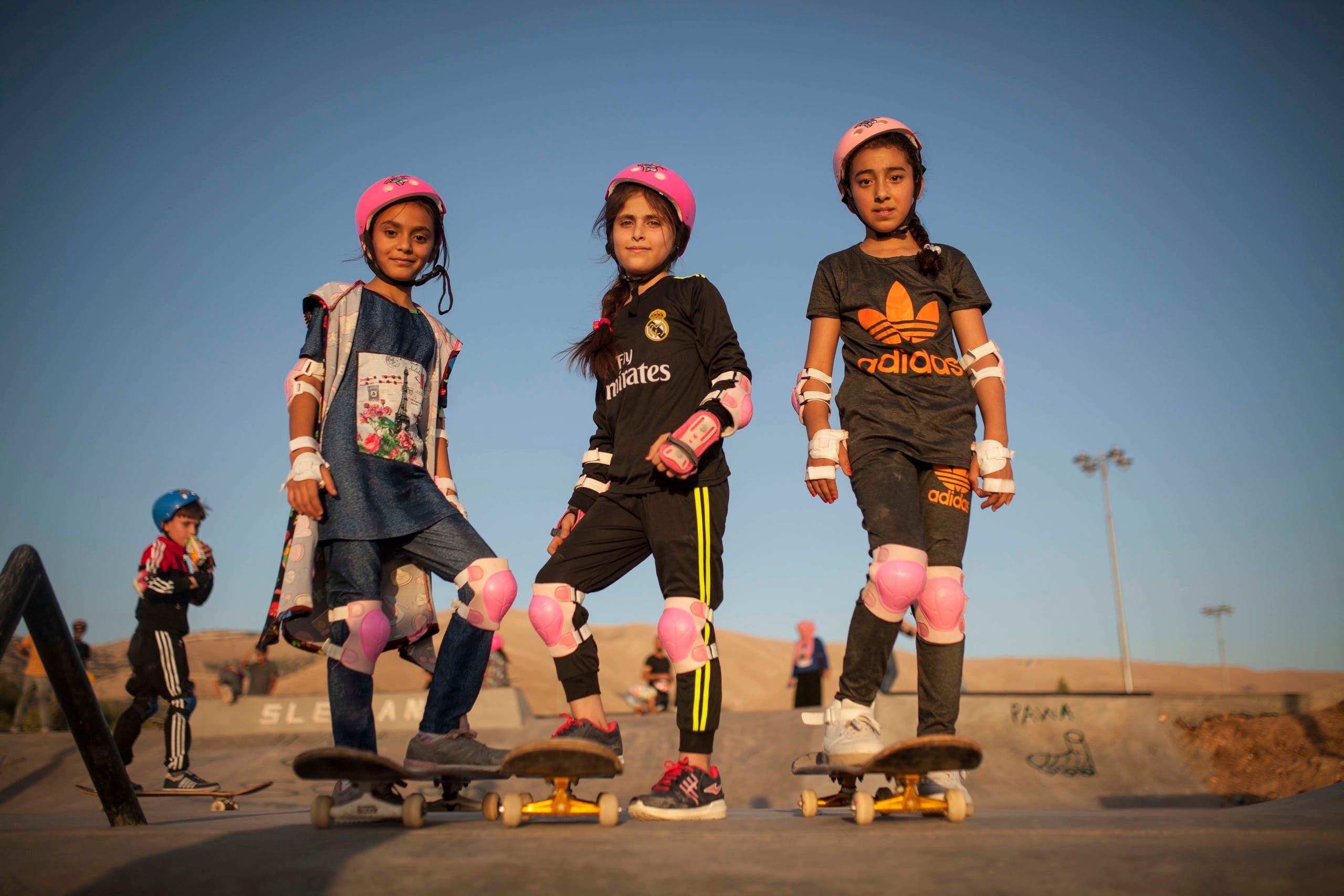 Girls pose at Iraq's Suli Skatepark. (Image: Make Life Skate Life)
