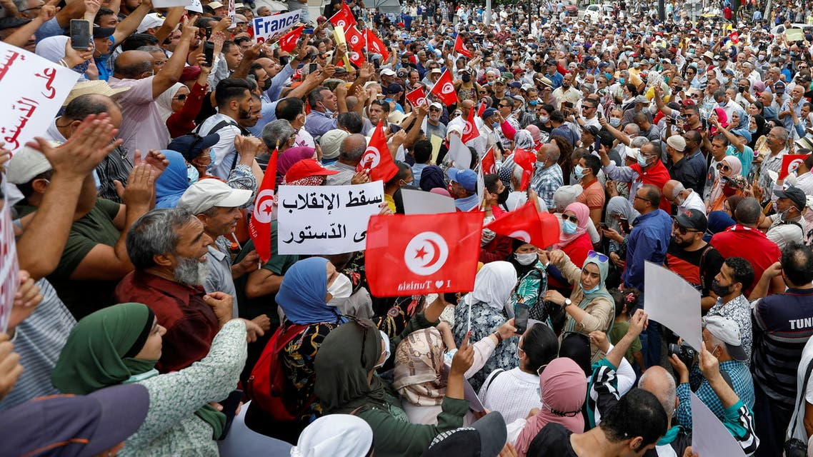 Opponents of Tunisia's President Kais Saied take part in a protest against what they call his coup on July 25, in Tunis, Tunisia September 18, 2021. (Reuters)