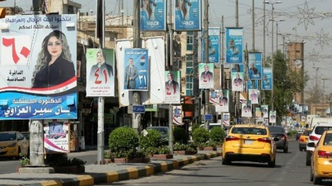صور المرشحين للانتخابات العراقية معلقة في الشوارع (أرشيفية- فرانس برس)