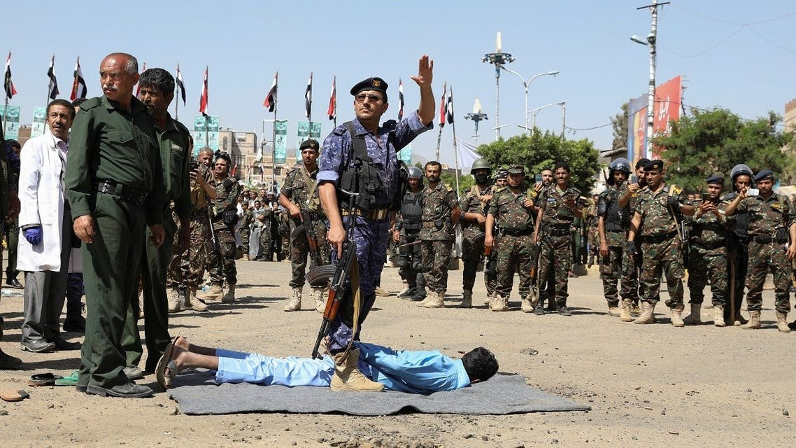 An executioner gestures before he executes a man convicted of involvement in the 2018 killing of top Houthi leader Saleh al-Samad, at Tahrir Square in Sanaa, Yemen September 18, 2021. (Reuters)
