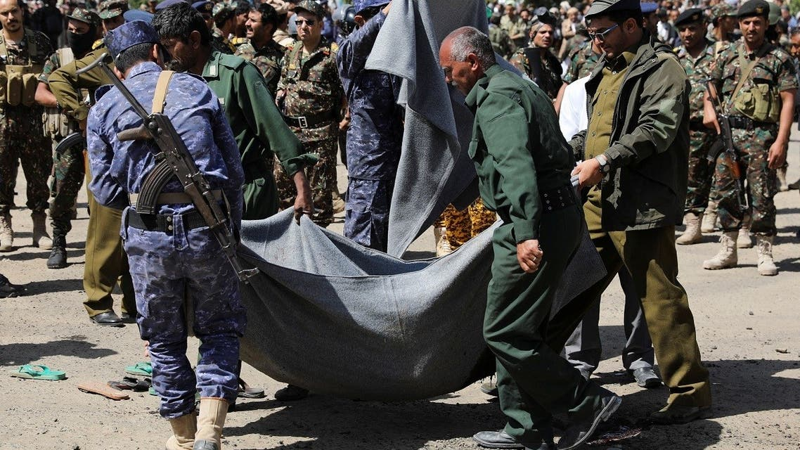Policemen carry the body of a man, convicted of involvement in the 2018 killing of top Houthi leader Saleh al-Samad, after his execution at Tahrir Square in Sanaa, Yemen. (Reuters)