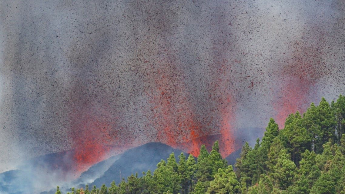 Lava and smoke rise following the eruption of a volcano in the Cumbre Vieja national park at El Paso, on the Canary Island of La Palma, September 19, 2021. (AFP)