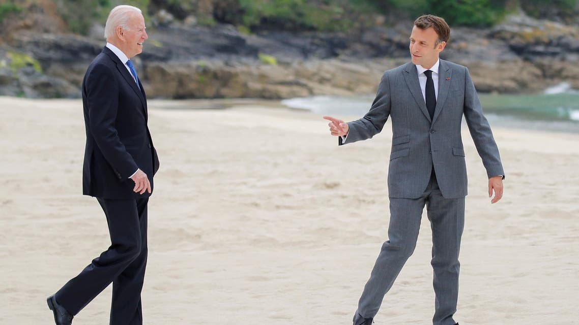 U.S.President Joe Biden and France's President Emmanuel Macron walk along the boardwalk during the G7 summit in Carbis Bay, Cornwall, Britain, June 11, 2021. (Reuters)