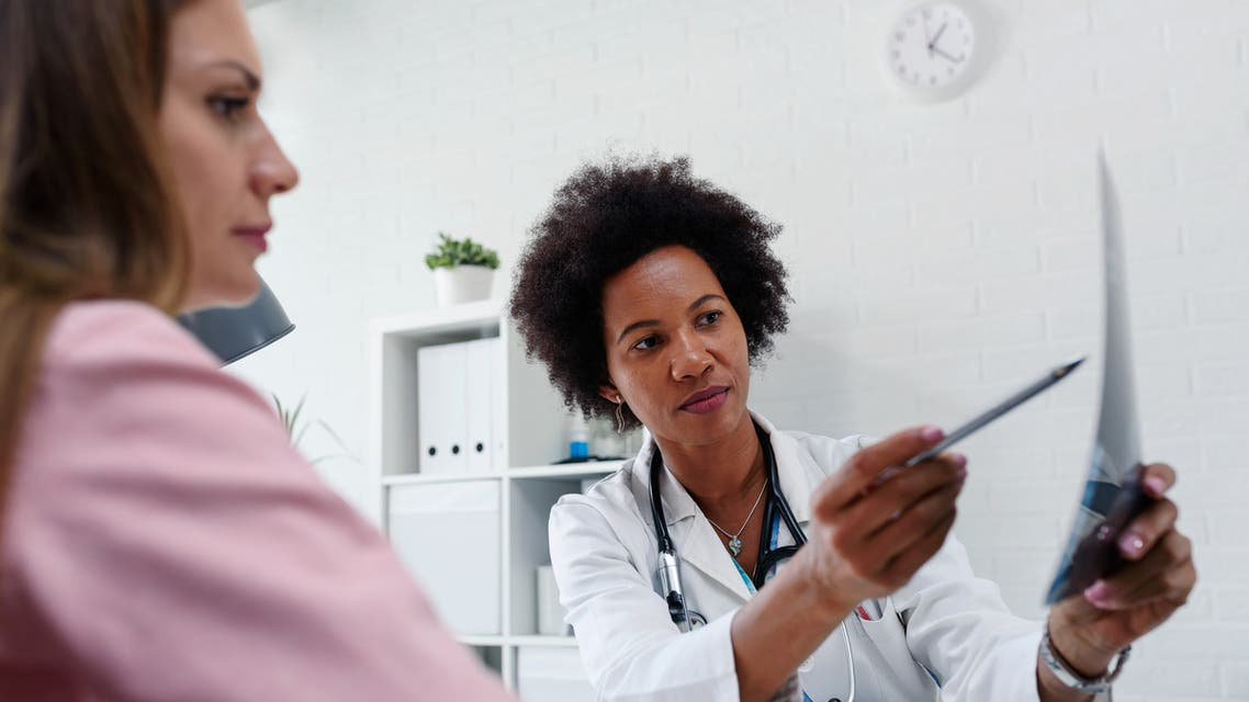 Female doctor looking at test results of her patient. (iStock)