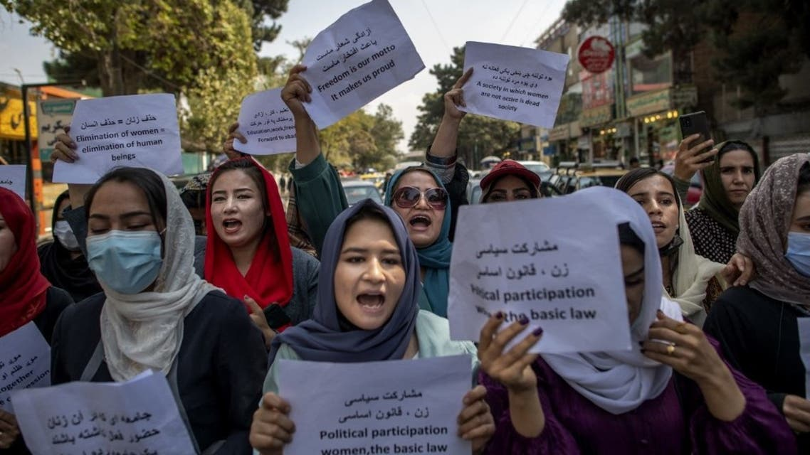 Afghan women hold placards during a demonstration demanding better rights for women in front of the former Ministry of Women Affairs in Kabul on September 19, 2021. (AFP)