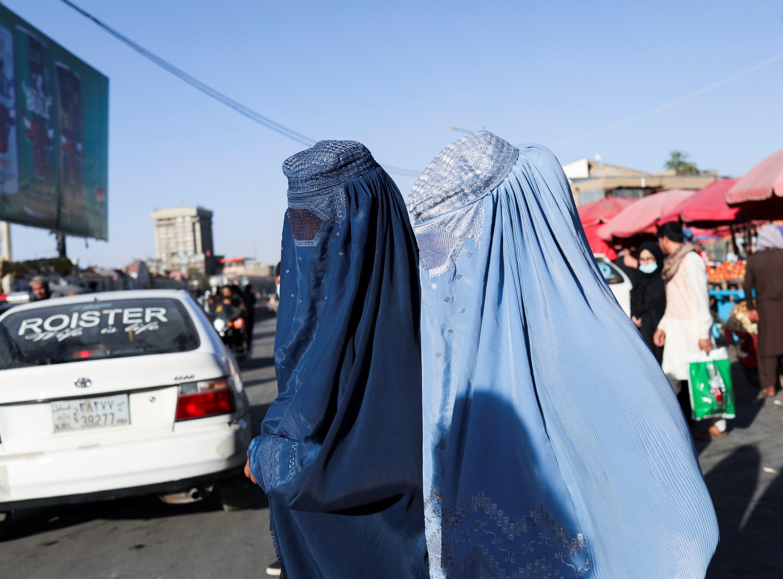 Afghan women walk down a street in Kabul, Afghanistan, September 16, 2021. (Reuters)