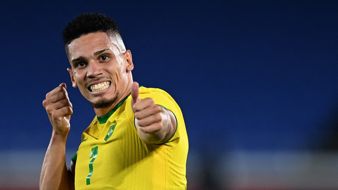Brazil's former midfielder Paulinho celebrates after he scored his side's fourth goal during the Tokyo 2020 Olympic Games men's group D first round football match between Brazil and Germany at the Yokohama International Stadium in Yokohama on July 22, 2021. (AFP)