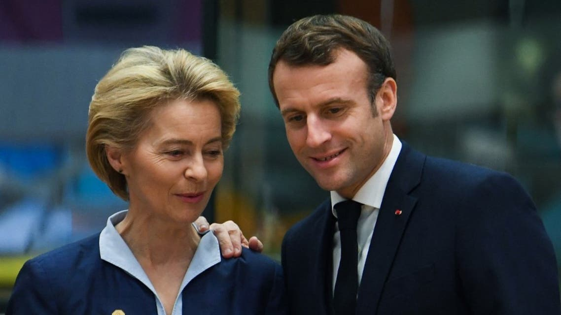 President of the European Commission Ursula von der Leyen (L) and France's President Emmanuel Macron speak prior to a European Union Summit at the Europa building in Brussels on December 12, 2019. (AFP)
