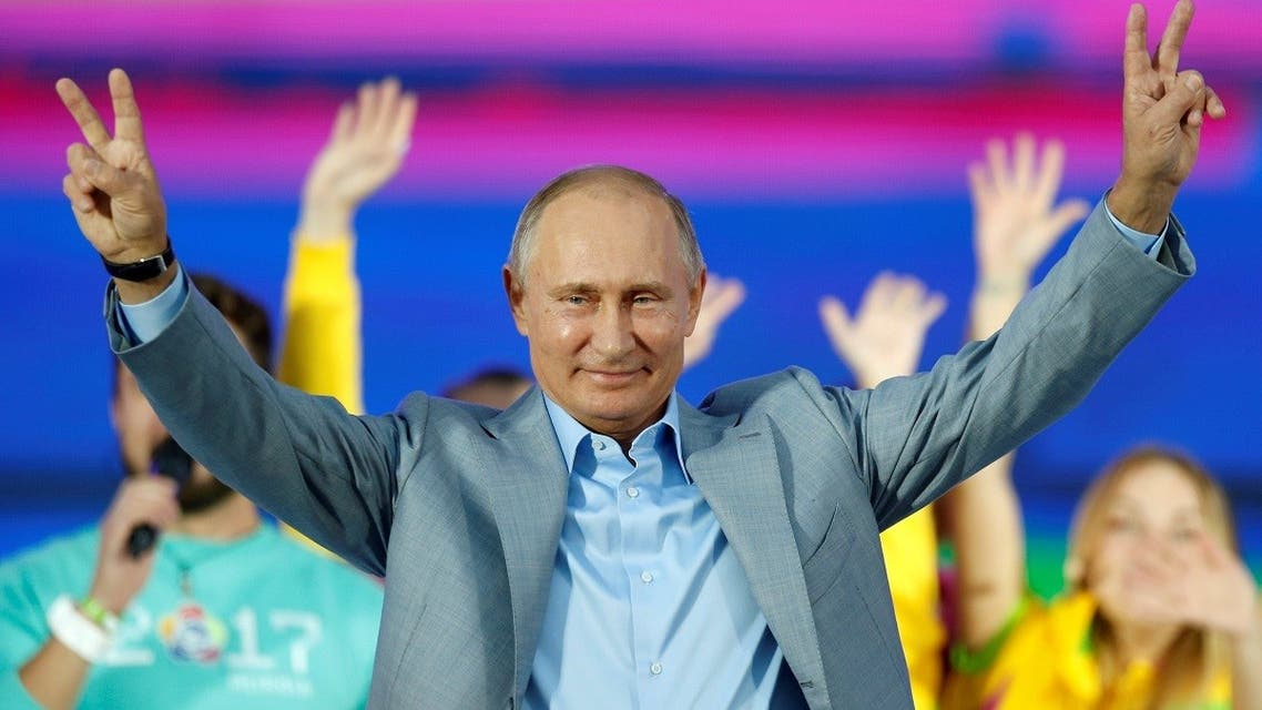 Russian President Vladimir Putin waves to participants of the 19th World Festival of Youth and Students during the closing ceremony at the Olympic Park in Sochi. (Reuters)