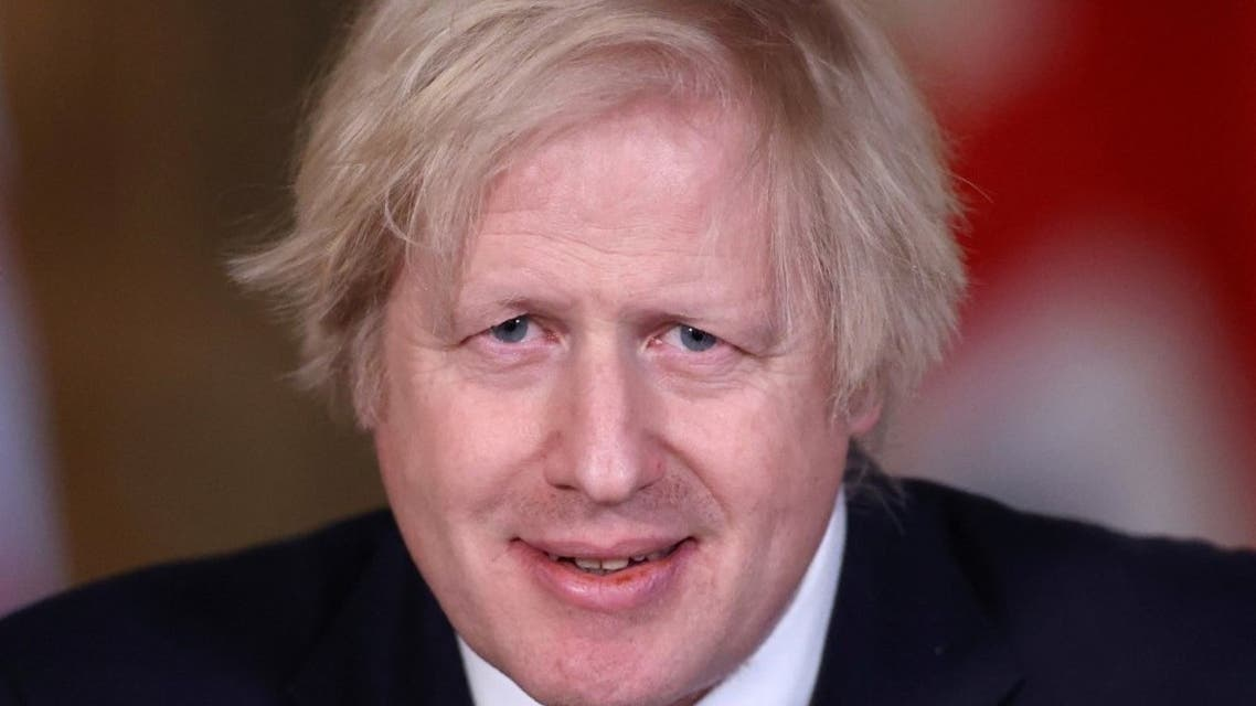 Britain's Prime Minister Boris Johnson smiles as he attends a virtual press conference inside 10 Downing Street in central London on March 8, 2021. (AFP)