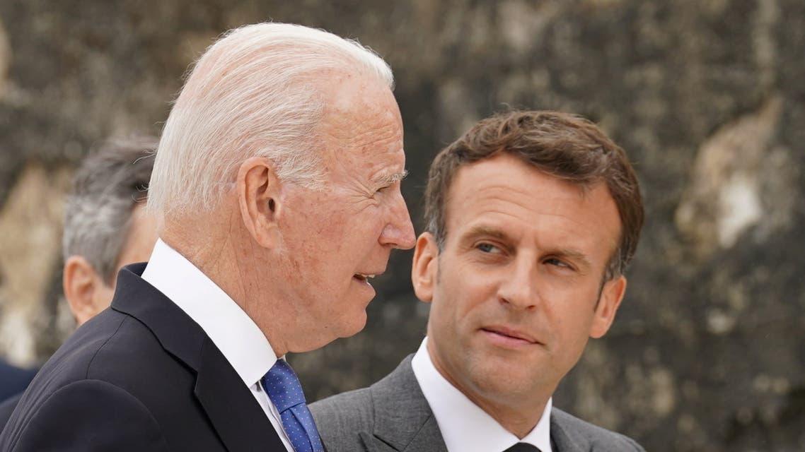 President Joe Biden and France's President Emmanuel Macron walk along the boardwalk during the G7 summit in Carbis Bay, Cornwall, June 11, 2021. (Reuters)