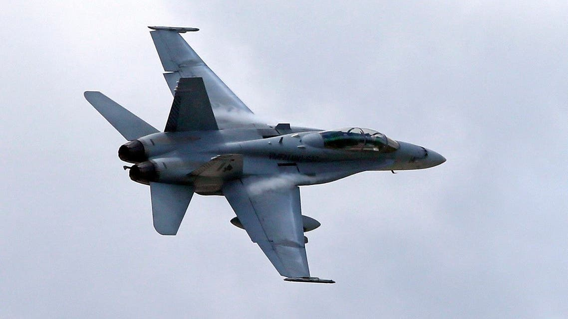 In this April 12, 2013, file photo, a U.S. Marine F/A-18 Hornet jet flies low pass during Philippines-US joint military exercise in northern Philippines. (AP)