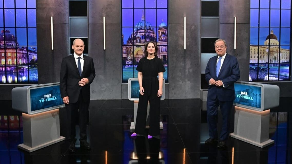 Top candidates for the upcoming German general elections (L-R) Olaf Scholz of the Social Democrats SPD, Annalena Baerbock of Germany's Greens (Die Gruenen) and Armin Laschet of the conservative CDU/CSU party union pose for pictures before a Triell television debate on September 19, 2021 in Berlin. (AFP)