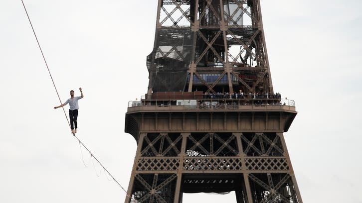 French slackliner scales 70-meter high rope from Eiffel Tower