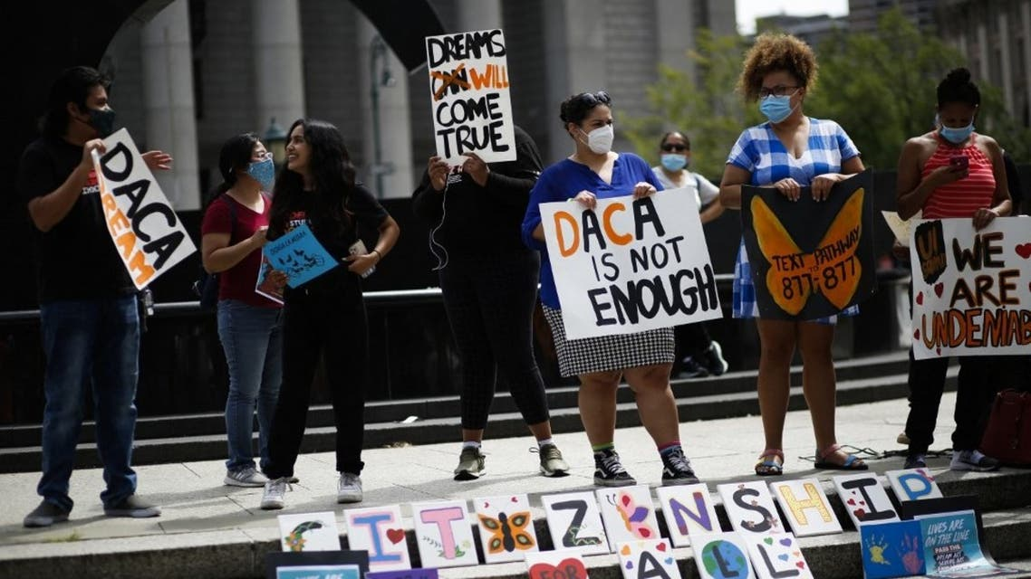People attend a protest supporting DACA, Deferred Action for Childhood Arrivals, at Foley Square in New York, on August 17, 2021. (AFP)