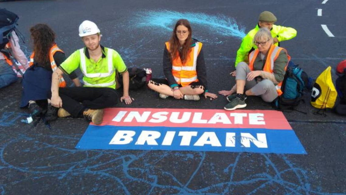 Members of Insulate Britain, demanding that the British government helps provide insulation for 29 million homes, block part of the M25 motorway near London, Britain, September 20, 2021, in this image obtained from social media. Insulate Britain. (Reuters)