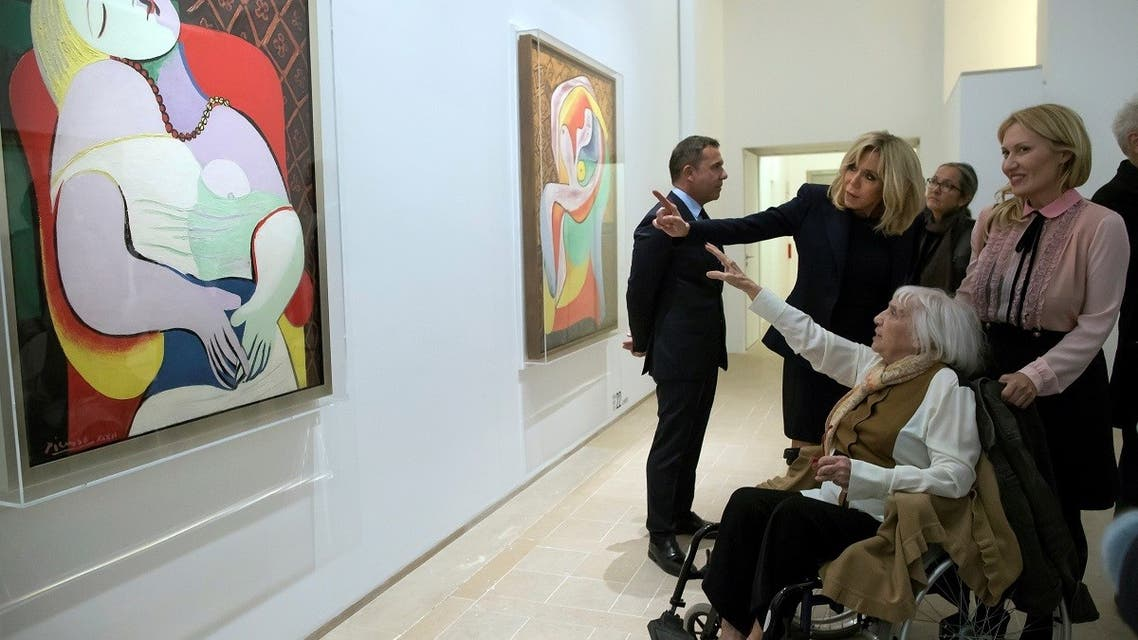 Brigitte Macron, the wife of the French President, talks with daughter of Spanish painter Pablo Picasso, Maya Picasso (bottom), and her son Olivier (L) and daughter Diana (R) during a visit of the Picasso 1932: Erotic Year exhibition at the Picasso Museum in Paris, France, October 8, 2017. (Reuters)