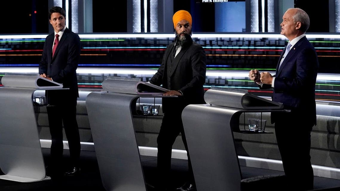 Liberal Leader Justin Trudeau, left to right, NDP Leader Jagmeet Singh, and Conservative Leader Erin O'Toole take part in the federal election English-language Leaders debate in Gatineau, Canada, September 9, 2021. (Reuters)