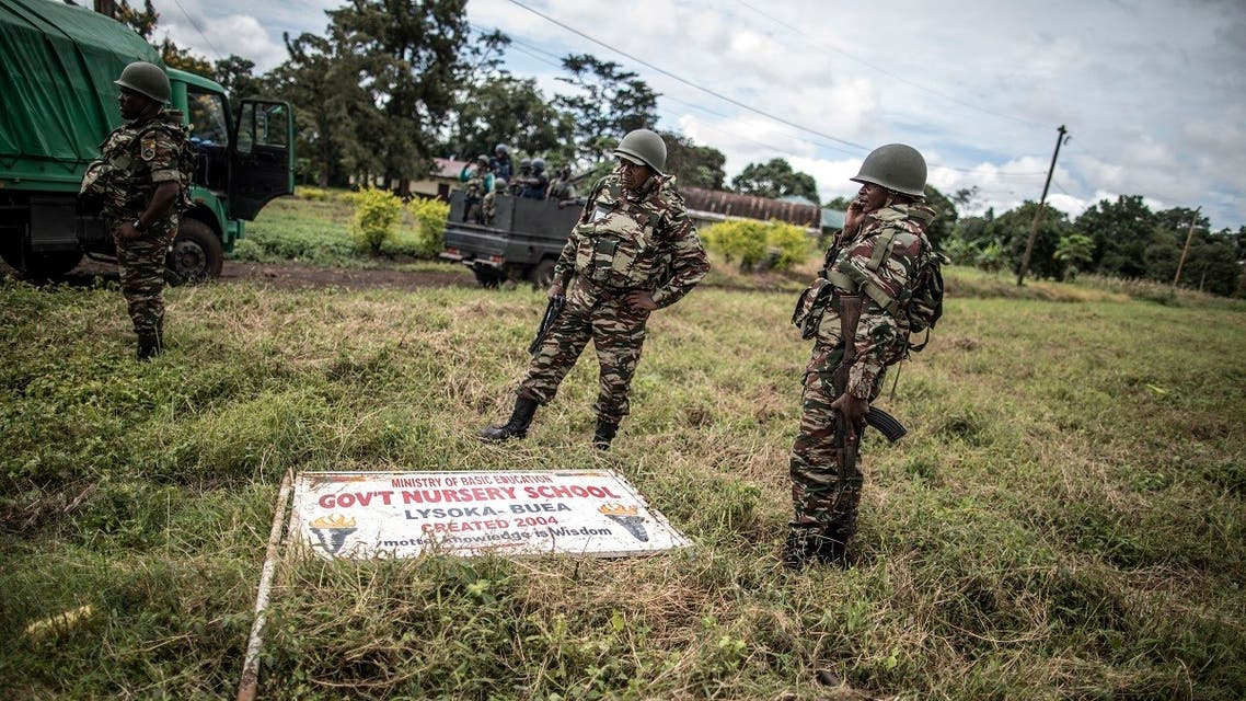 A file photo shows Cameroonian army soldiers secure the perimeter of a polling station in Lysoka, near Buea, southwestern Cameroon, on October 7, 2018. (Marco Longari/AFP)