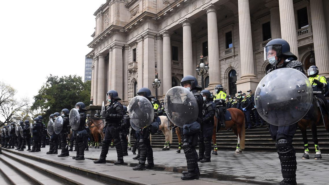 Riot police guard Victoria's Parliament House as construction workers and far right activists protest against coronavirus disease (COVID-19) restrictions in Melbourne, Australia, September 21, 2021. (Reuters)