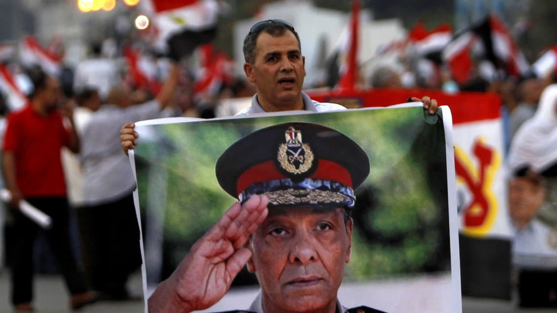 A supporter of former prime minister and presidential candidate Ahmed Shafik holds a poster of Field Marshal Mohamed Hussein Tantawi, the head of the ruling Supreme Council of the Armed Forces (SCAF) during a rally in front of the military parade stand at Nasr City in Cairo June 23, 2012. (File photo: Reuters)