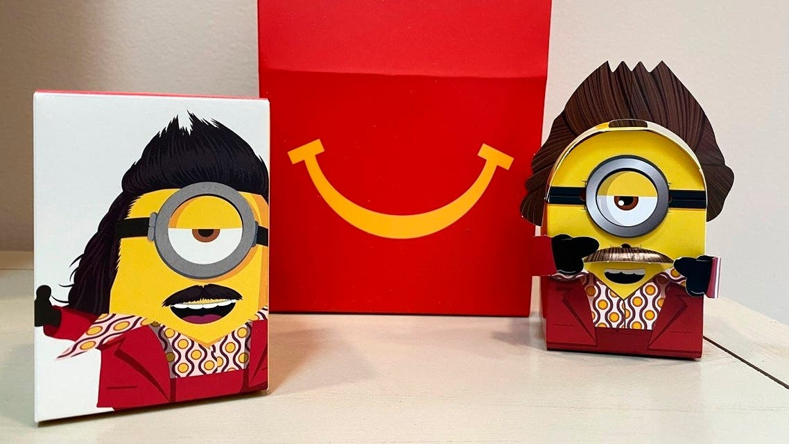 A cardboard McDonald's Happy Meal toy is shown with a Happy Meal box on Sept. 20, 2021. (AP/Dee-Ann Durbin)(1)