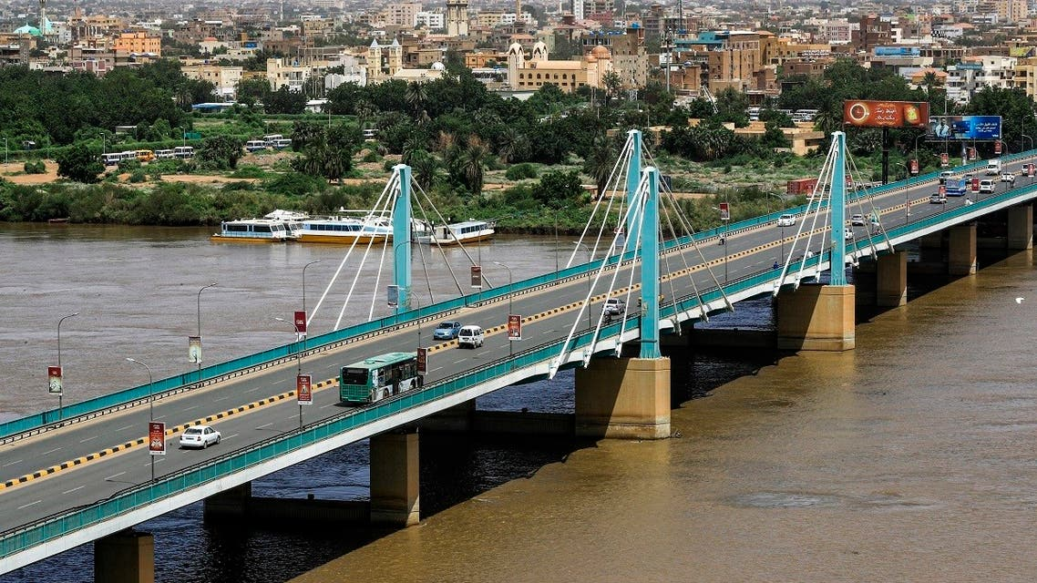 This picture taken on September 21, 2021 shows a view of the Mek Nimr Bridge across the Blue Nile river, linking the centre of Sudan's capital Khartoum with the adjacent city of Khartoum North (background). (AFP)