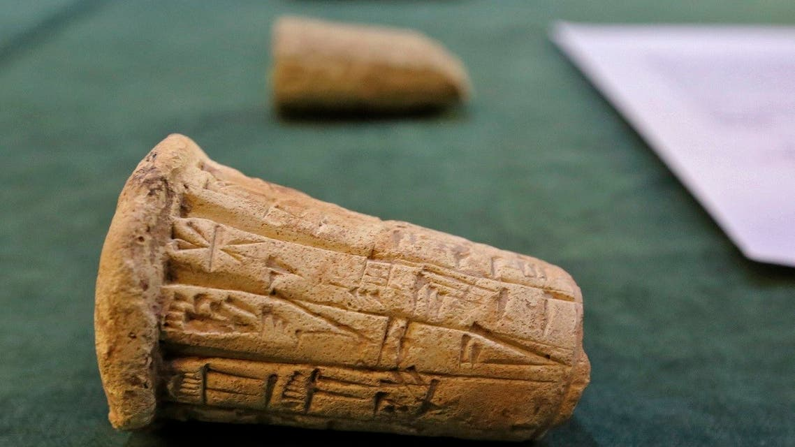 Mesopotamian clay cones bearing cuneiform inscriptions are displayed during a handover ceremony of a trove of looted Iraqi antiquities returned by the US, Aug. 3, 2021. (AFP)