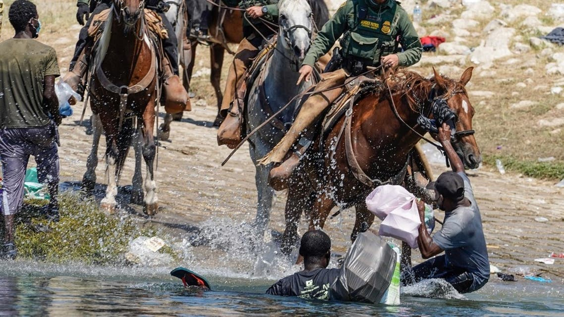 In this file photo United States Border Patrol agents on horseback try to stop Haitian migrants from entering an encampment on the banks of the Rio Grande near the Acuna Del Rio International Bridge in Del Rio, Texas on September 19, 2021. (Paul Ratje/AFP)