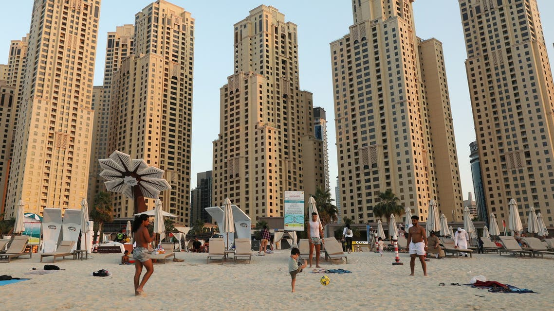 People play football at Jumeirah beach residence in Dubai, United Arab Emirates December 23, 2020. (Reuters)