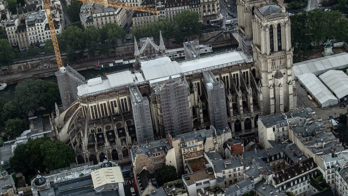"""An aerial picture taken on July 12, 2021 shows a view of the Notre-Dame de Paris Cathedral on the """"Ile de la Cite"""" island in the Seine river in Paris. (Bertrand Guay/AFP)"""