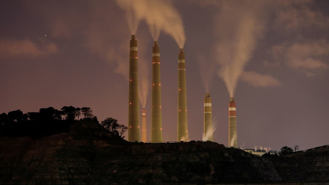 Smoke and steam billows from the coal-fired power plant owned by Indonesia Power, in Suralaya, Indonesia, July 11, 2020. (Reuters)