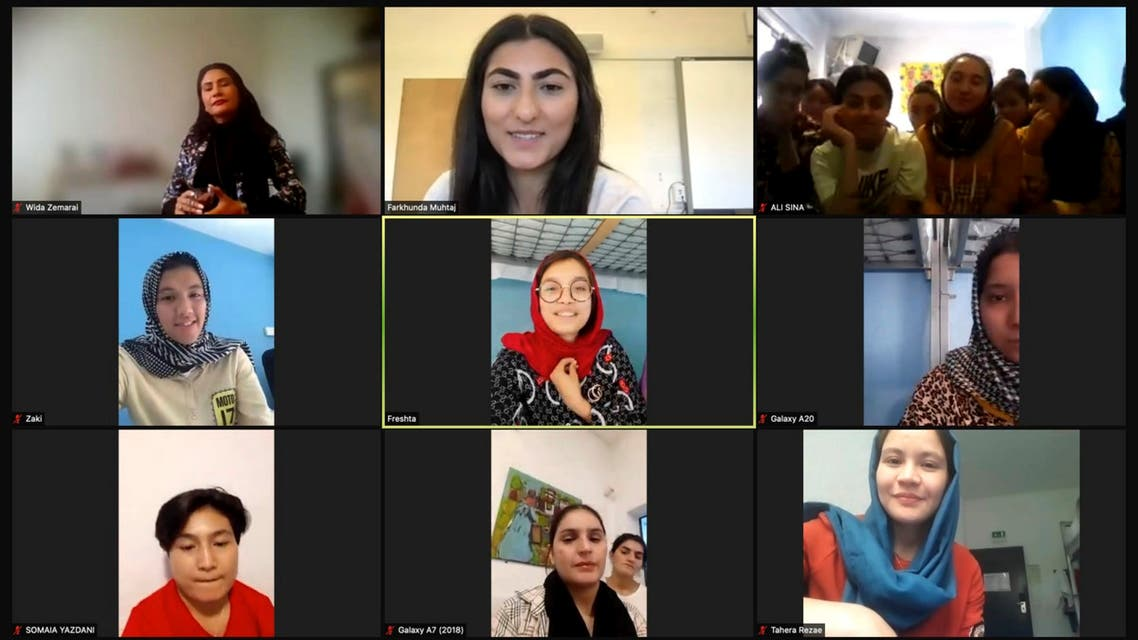 Farkhunda Muhtaj, the captain of the Afghanistan women's national soccer team, top center, is seen with members of the Afghanistan national girls soccer team and others on Monday, Sept. 20, 2021, during a Zoom interview with The Associated Press. Late Sunday night, almost three weeks after the American withdrawal from Afghanistan, the girls and their families landed in Lisbon, Portugal, after an international coalition came to their rescue. (File photo: AP)
