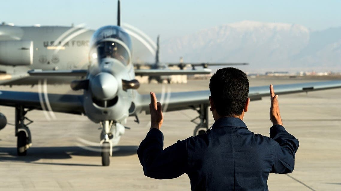 A member of the Afghan Air Force marshals in a A-29 Super Tucano at Hamid Karzai International Airport. (File Photo: Reuters)
