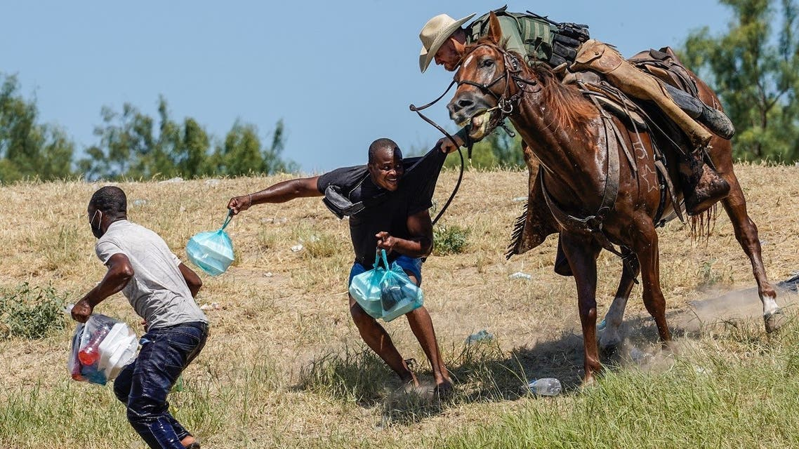 US Border Patrol agent on horseback tries to stop a Haitian migrant from entering in Del Rio, Texas, Sept. 19, 2021. (AFP)