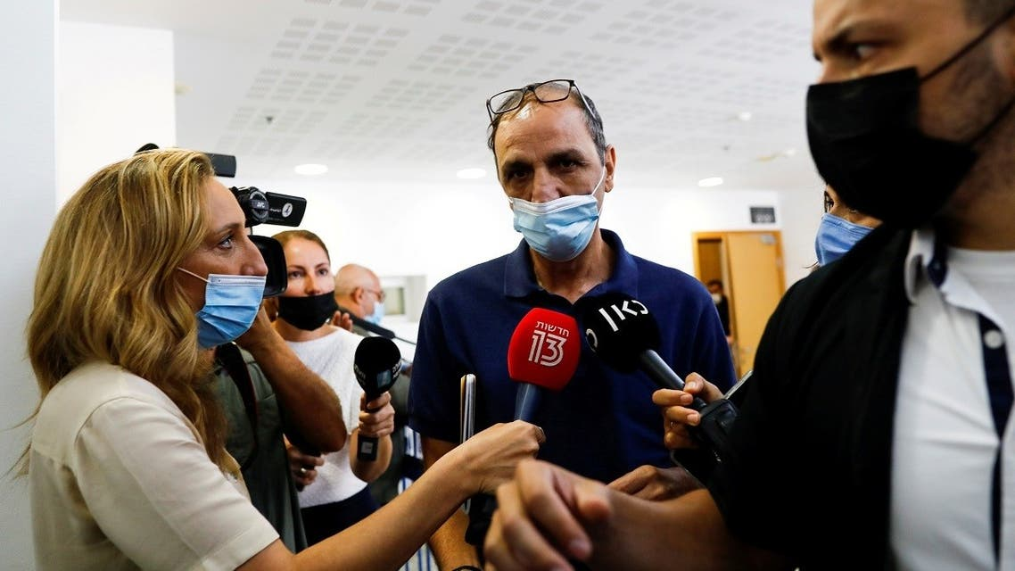 Shmuel Peleg, the grandfather of Eitan Biran, a six-year-old boy who was the only survivor of an Italian cable car disaster and is now at the centre of a custody battle, declines to speak to members of the media after a court hearing in Tel Aviv, Israel, on September 23, 2021. (Reuters)