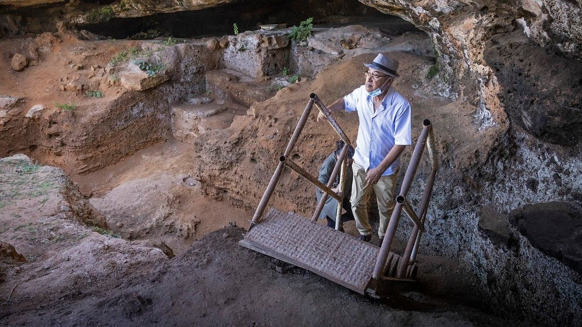 Archeologists walk to enter the Contrebandiers (Smugglers) Cave less than 20 kilometers from the Moroccan capital Rabat, on September 18, 2021. (Fadel Senna/AFP)