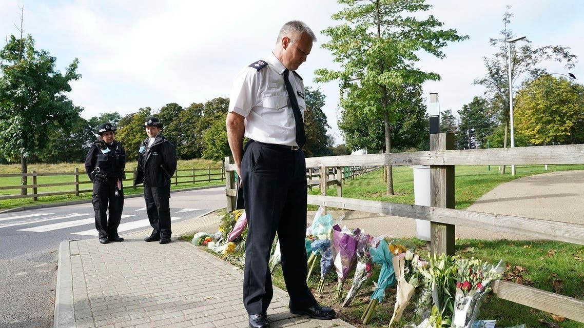 Chief Superintendent Trevor Lawry stands by the floral tributes at Cator Park in Kidbrooke, near to the area where the body of Sabina Nessa was found, in London, on Sept. 23, 2021. (AP)