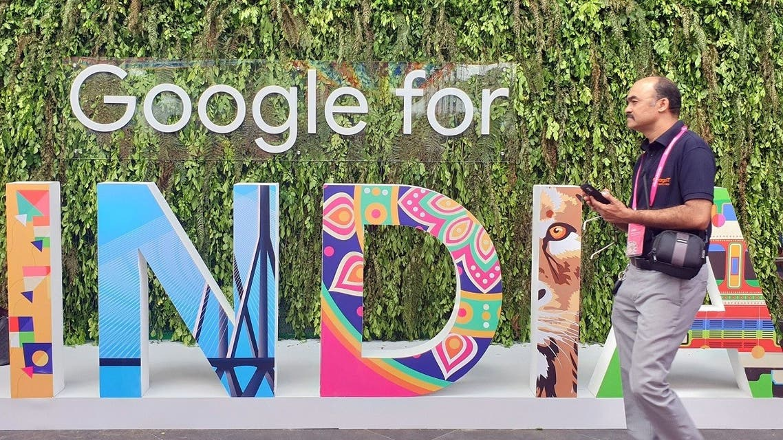 A man walks past the sign of Google for India, the company's annual technology event in New Delhi, India. (Reuters)