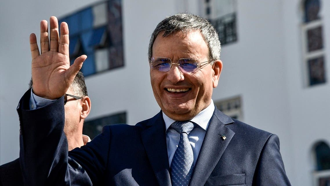 Ali Ghediri waves as he arrives to submit his candidacy before the constitutional council, March 3, 2019. (AFP)