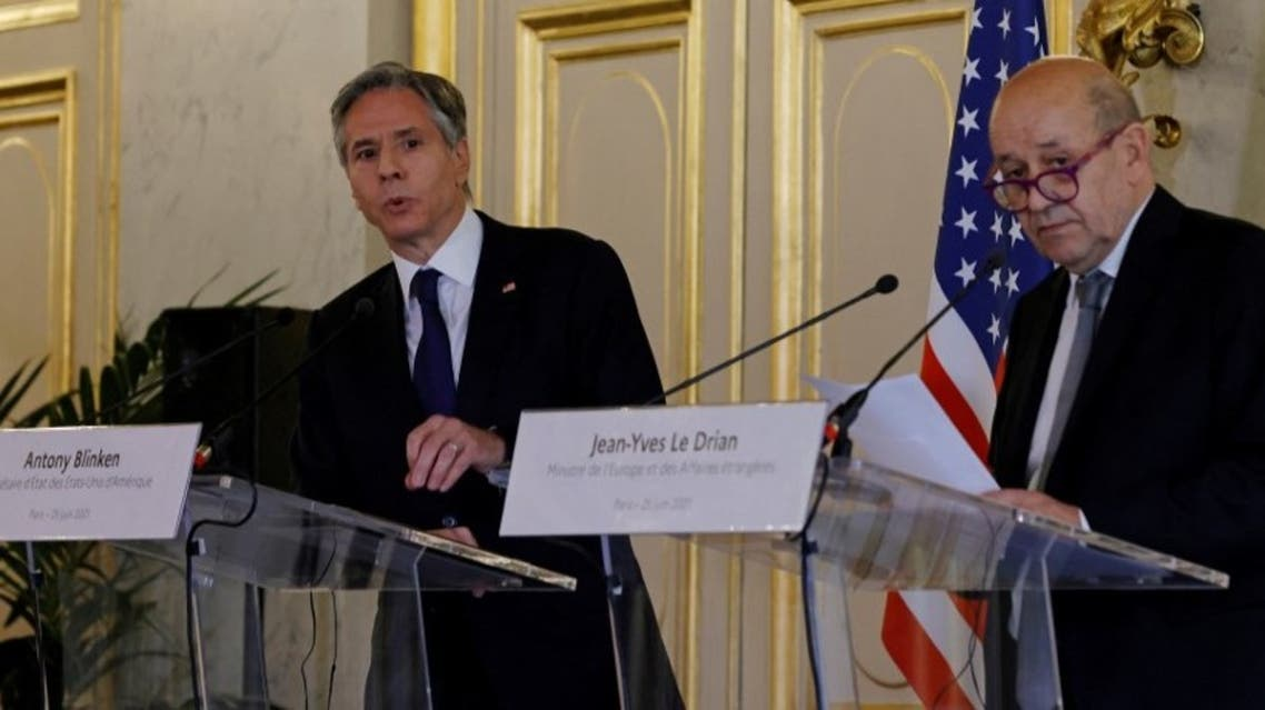 US Secretary of State Antony Blinken (L) and French Foreign Affairs Minister Jean-Yves Le Drian attend a joint press conference at the French Ministry of Foreign Affairs in Paris, on June 25, 2021. (AFP)
