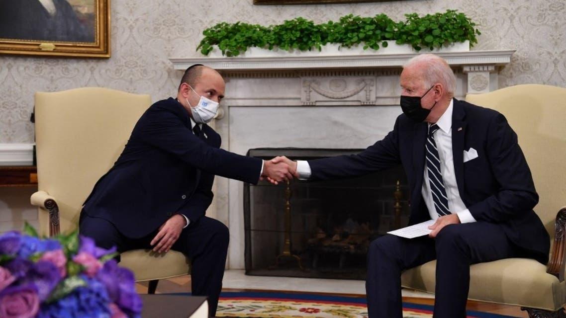 US President Joe Biden shakes hands with Israeli Prime Minister Naftali Bennett in the Oval Office of the White House in Washington, DC, on August 27, 2021. (AFP)