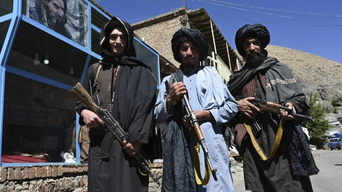 Taliban fighters pose for a picture in front of a bakery at a market area in Khenj district, Panjshir Province on September 15, 2021. (AFP)