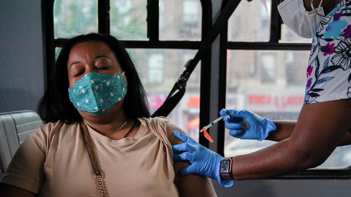 A person receives a dose of the Pfizer-BioNTech vaccine for the coronavirus disease (COVID-19), at a mobile inoculation site in the Bronx borough of New York City, New York, US, August 18, 2021. (Reuters)