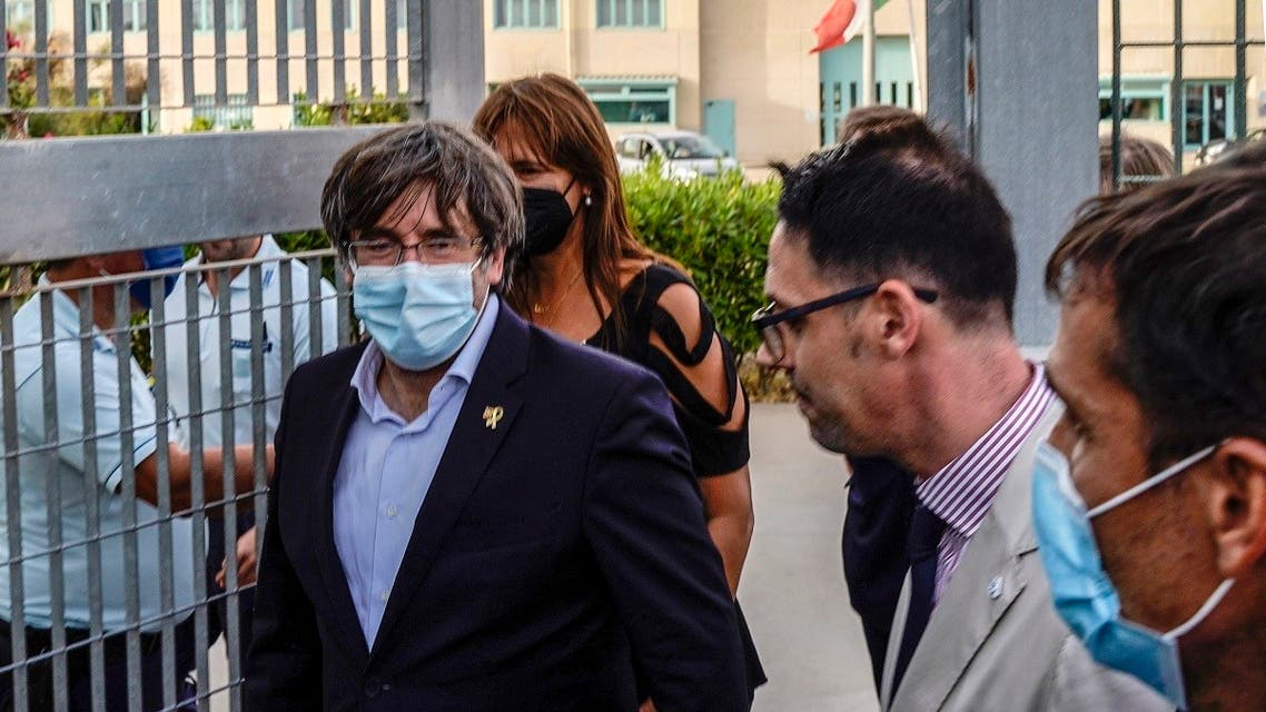Exiled former Catalan president Carles Puigdemont leaves after being released from jail on September 24, 2021 in Sassari, Sardinia island, Italy. (Gianni Biddau/AFP)