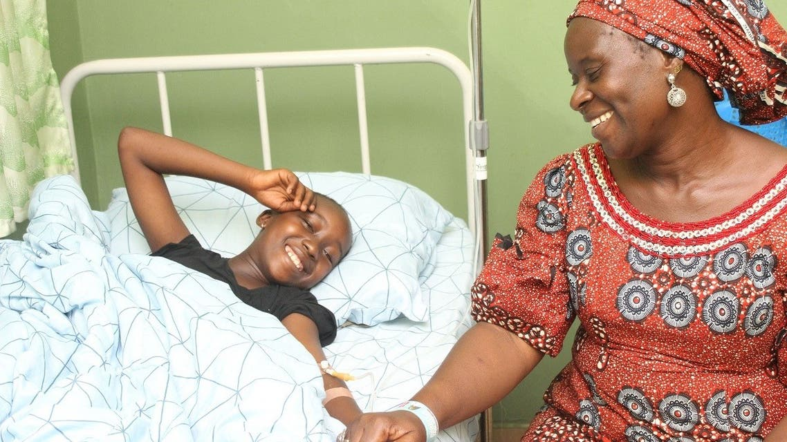 Bennice John Bivan (11), one of the 28 students of Bethel Baptist High School who have been released by their kidnappers is seen with her mother Rahila John Bivan at Wilbasun Hospital and Maternity in Kaduna on July 26, 2021. (AFP)