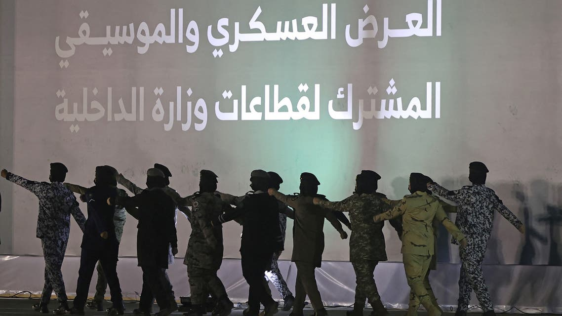 Members of a female military unit participate in a celebratory march past during the Saudi National Day celebrations in Riyadh, Saudi Arabia, September 23, 2021. (AFP)
